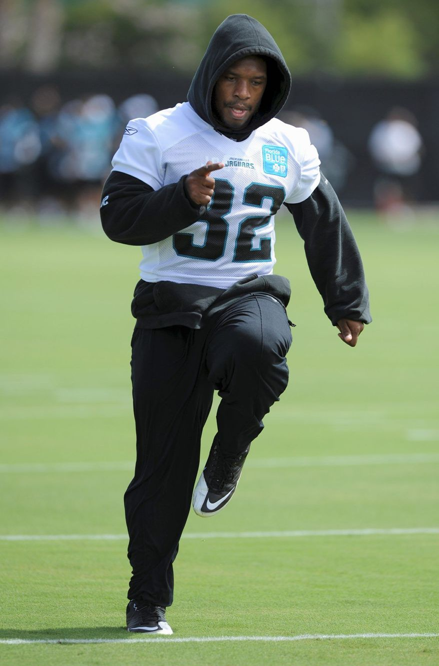 associated press Jacksonville's Maurice Jones-Drew participates in drills apart from his teammates as a rehabilitates from offseason knee surgery.