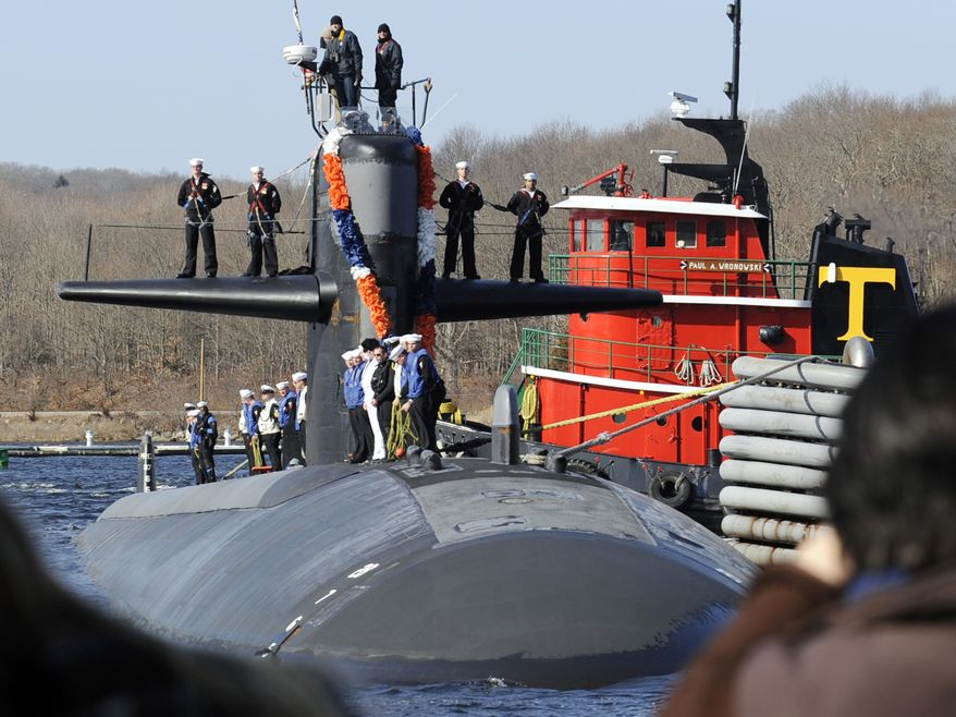** FILE ** In this March 2, 2011 file photo, the Los Angeles Class attack submarine USS Memphis returns to the U.S. Navy Submarine Base in Groton, Conn., after a two-month deployment that was its final mission. When the Navy discovered a cheating ring aboard the USS Memphis, it swiftly fired the commanding officer and kicked off 10 percent of the crew. (AP Photo/The Day, Sean D. Elliot, File)