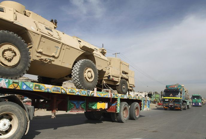 ** FILE ** A convoy of trucks carries U.S. equipment in Kabul, Afghanistan, on Jan. 17, 2010. (Associated Press)