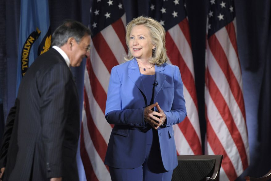 Secretary of State Hillary Rodham Clinton and Defense Secretary Leon E. Panetta arrive for an event at the National Defense University in Washington on Tuesday, Aug. 16, 2011. (AP Photo/Susan Walsh)