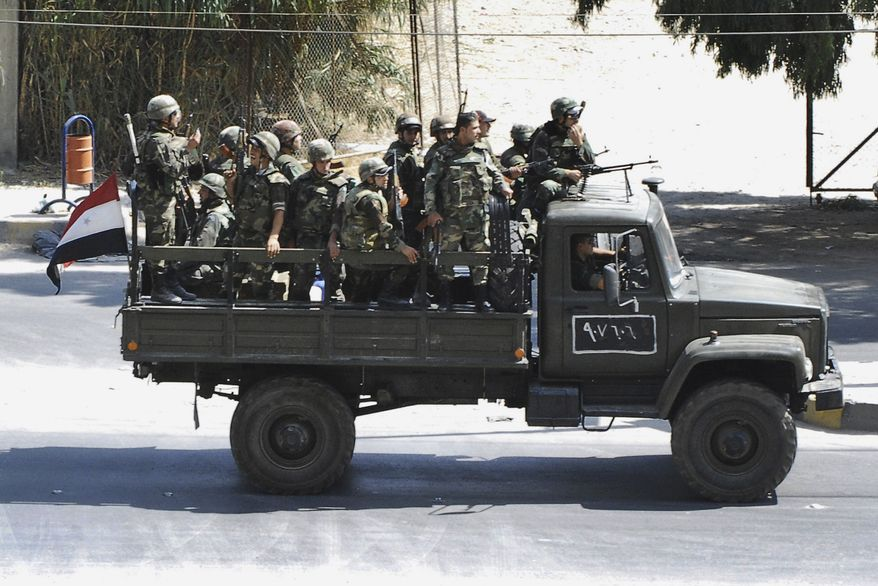 Syrian troops withdraw from the Damascus suburb of Saqba, Syria, on Sunday, Aug. 14, 2011, following a campaign of raids and arrests that started overnight and continued Sunday morning. The image was taken by a citizen journalist. (AP Photo)