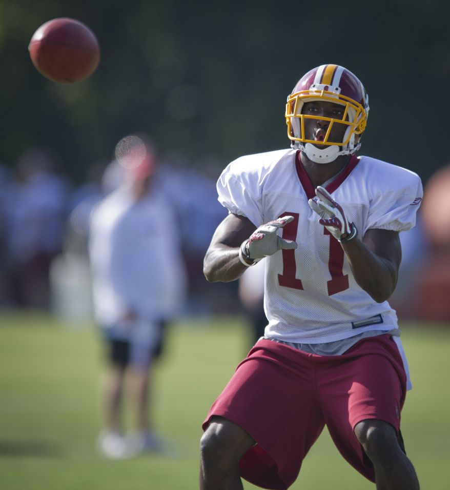 ** FILE ** Washington Redskins wide receiver Aldrick Robinson pulls in a pass during practice at Redskins Park in Ashburn, Va., ON Tuesday, Aug. 16, 2011. (Rod Lamkey Jr./The Washington Times)