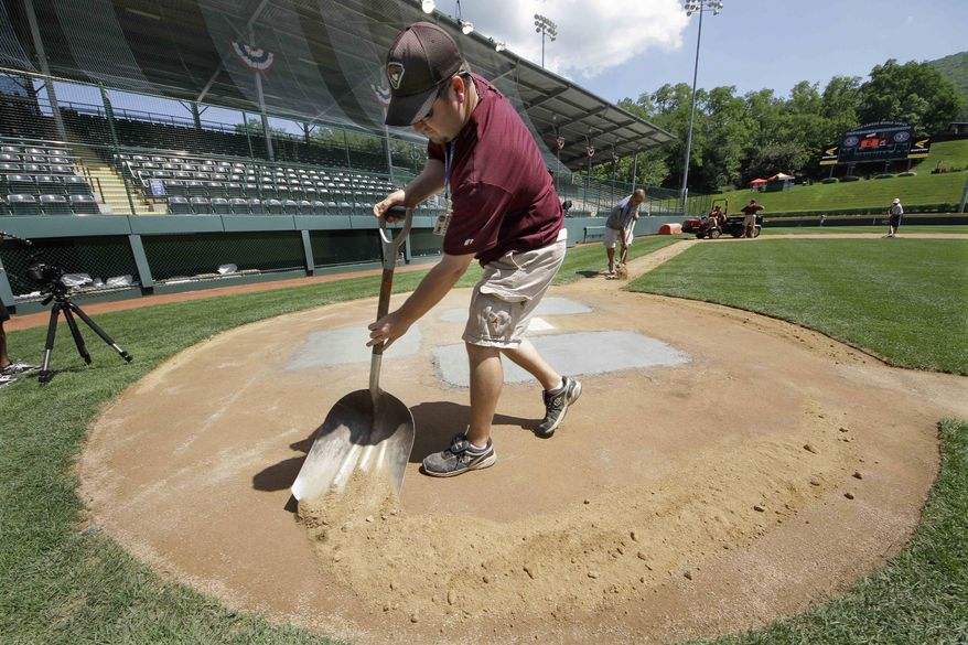 Grounds crew member Brad Garrison tends to the field in preparation for the Little League World Series, which begins Thursday. (Associated Press)