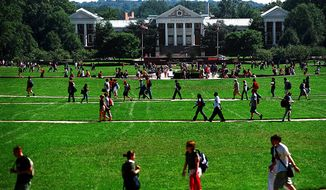 Students crisscross the campus of the University of Maryland at College Park. (The Washington Times) ** FILE **