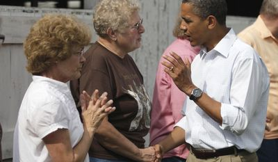 President Obama, wrapping up a three-day bus trip through the Midwest, speaks with Norma Haan (center), 68, at the Whiteside County Fair in Morrison, Ill., on Wednesday, Aug. 17, 2011. The woman at left was not identified. (AP Photo/Carolyn Kaster)