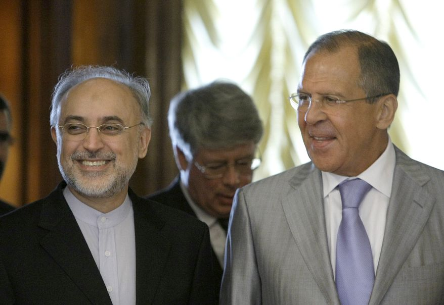 Russian Foreign Minister Sergey Lavrov (right) and his Iranian counterpart, Ali Akbar Salehi, walk to their meeting in Moscow on Wednesday, Aug. 17, 2011. (AP Photo/Misha Japaridze)