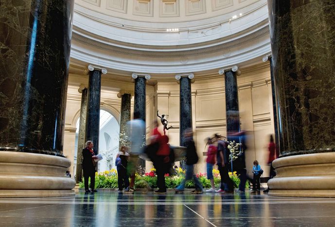 """Patrons walk through the National Gallery of Art in Washington on April 8, a week after Matisse's """"The Plumed Hat"""" was vandalized. (Associated Press)"""
