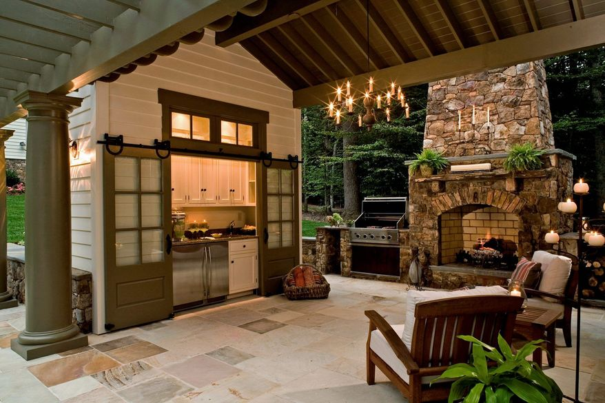Photograph courtesy of Rill ARchitects Outdoor Kitchens If you are including a fireplace as part of an outdoor kitchen, make sure it doesn't block the view from inside the house.