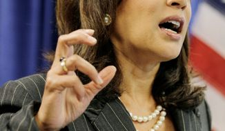 """""""They suggested that by joining this lawsuit, the banks would have to pay,"""" California Attorney General Kamala Harris said of defendants in an alleged scam. (Associated Press)"""