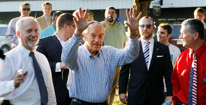 "Mr. Paul waves his arms as he arrives to a crowd of several hundred who came to see him on Wednesday in Concord, N.H. ""We had a lot of enthusiasm four years ago, but we didn't know how to organize it and direct it. We didn't really know how this system worked. So, we should do better and we should expect better,"" Mr. Paul said."