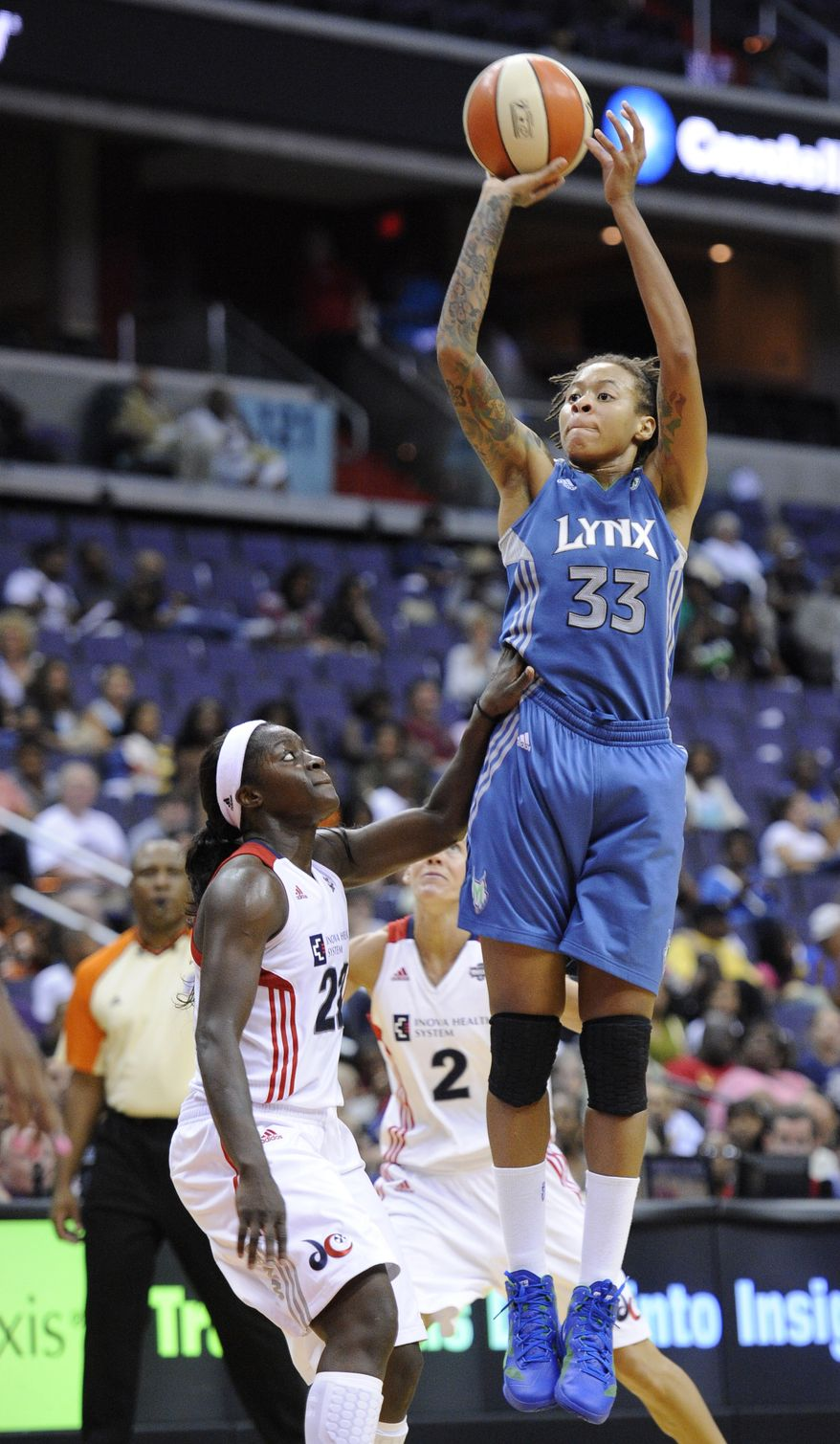 Minnesota Lynx's Seimone Augustus takes a shot over Washington Mystics' Matee Ajavon during the second half of Thursday night's game. The Lynx won 81-62. (AP Photo/Nick Wass)