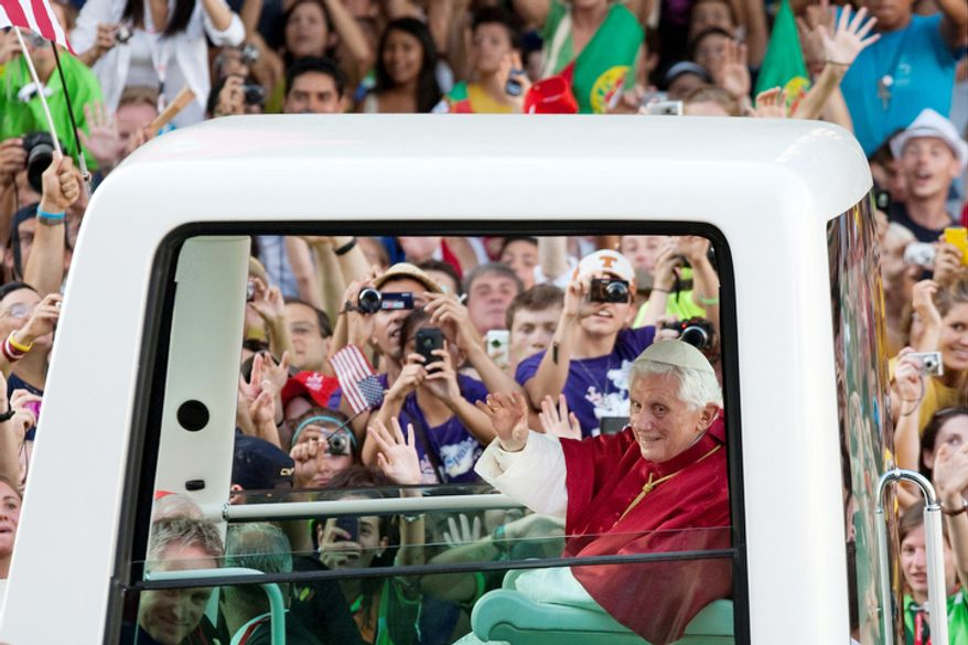 Pope Benedict XVI waves from his Popemobile in Puerta de Alcala square in Madrid on Thursday, Aug. 18, 201. Pope Benedict XVI is visiting Madrid between Aug. 18- 21.  Pope Benedict XVI warned Thursday at the start of a visit to crisis-hit Spain that Europe won't be able to emerge from its economic woes unless it realizes that economic policy cannot be guided by a profit-driven mentality alone but must take into account ethical considerations that look out for the common good.(AP Photo/Arturo Rodriguez)