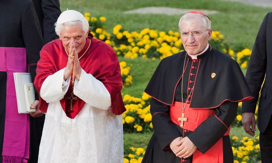Pope Benedict XVI, left, and Madrid's Archbishop Antonio Maria Rouco Varela, right, are seen at Puerta de Alcala square in Madrid on Thursday, Aug. 18, 201. Pope Benedict XVI denounced the profit-at-all-cost mentality that he says is behind Europe's current economic crisis as he arrived in hard-hit Spain on Thursday, and said morals and ethics must play a greater role in formulating economic policy in the future.  (AP Photo/Arturo Rodriguez)
