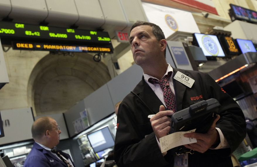 Trader Edward Baumann works on the floor of the New York Stock Exchange in New York on Thursday, Aug. 18, 2011. Worldwide economic gloom was causing markets to tumble. (AP Photo/Richard Drew)