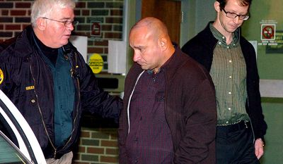 **FILE** In this photo from Nov. 21, 2008, Craighead County Chief Deputy Bob Sharp (left) escorts Jessie Lloyd Misskelley (center) and Charles Jason Baldwin as they leave the Craighead County Courthouse Annex at Jonesboro, Ark. (Associated Press/The Jonesboro Sun)