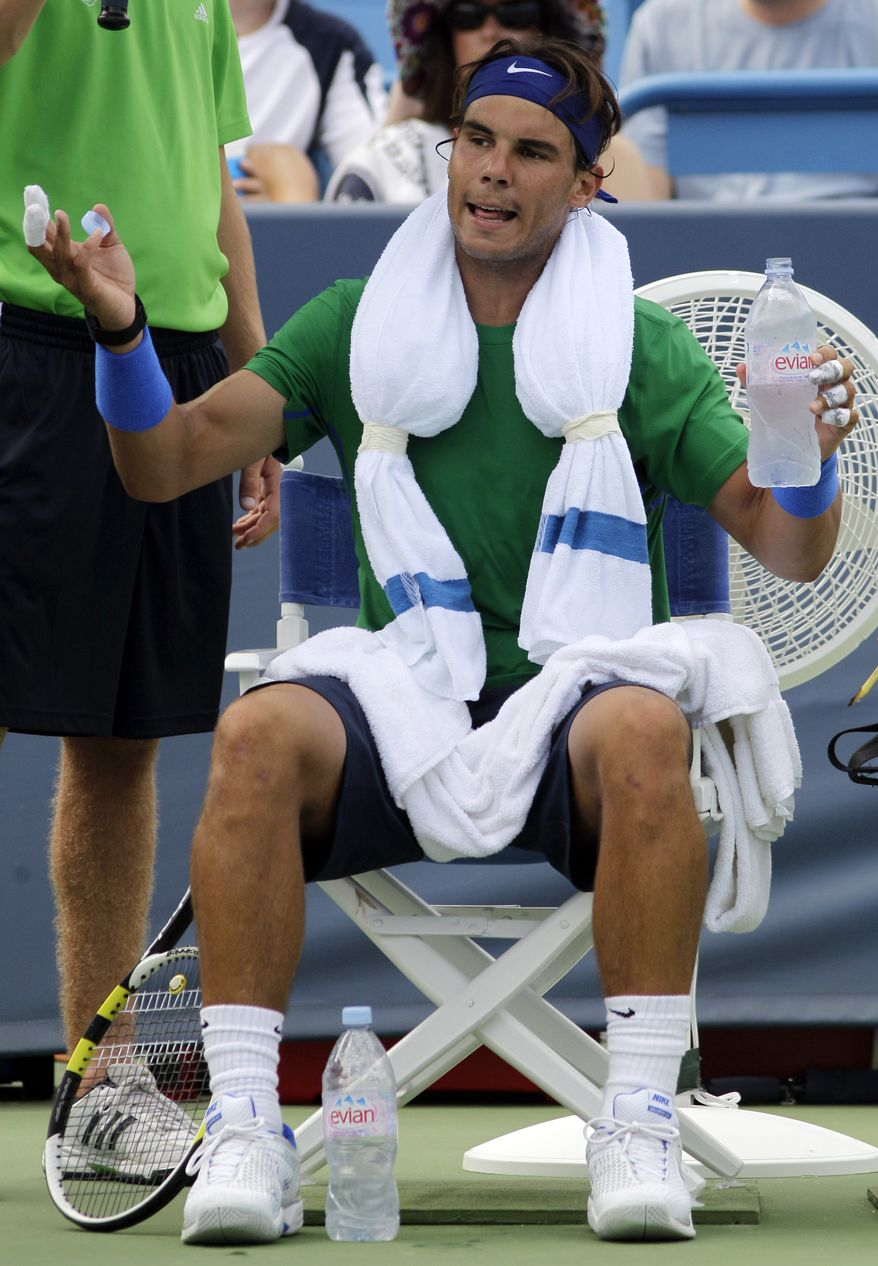 Rafael Nadal, from Spain, complains to the chair umpire during a change over in a quarterfinal match against Mardy Fish at the Western & Southern Open tennis tournament, Friday, Aug. 19, 2011 in Mason, Ohio. Fish won 6-3, 6-4. (AP Photo/Al Behrman)