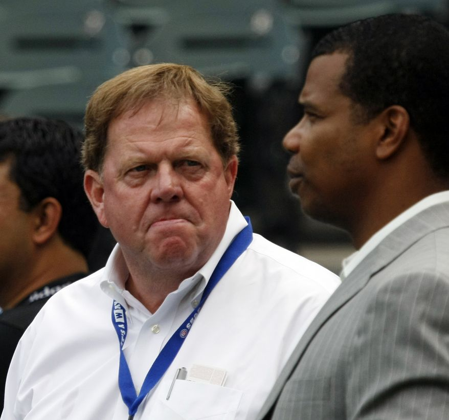 FILE - This June 20, 2011, file photo shows Chicago Cubs' general manager Jim Hendry, left, and Chicago White Sox general manager Kenny Williams, before an interleague baseball game in Chicago. The Cubs have fired Hendry after another disappointing season. The Cubs announced the move Friday, Aug. 19, 2011, before a game with the rival St. Louis Cardinals. (AP Photo/Charles Rex Arbogast, File)