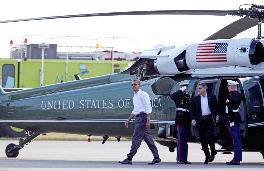 President Obama arrives Thursday on Marine One in West Tisbury, Mass., for a 10-day family vacation in Martha's Vineyard, Mass. Before leaving Washington, he signed an executive order freezing Syrian assets and banning U.S. imports of petroleum products that originate in Syria. It also bars Americans from investing in Syria. (Associated Press)