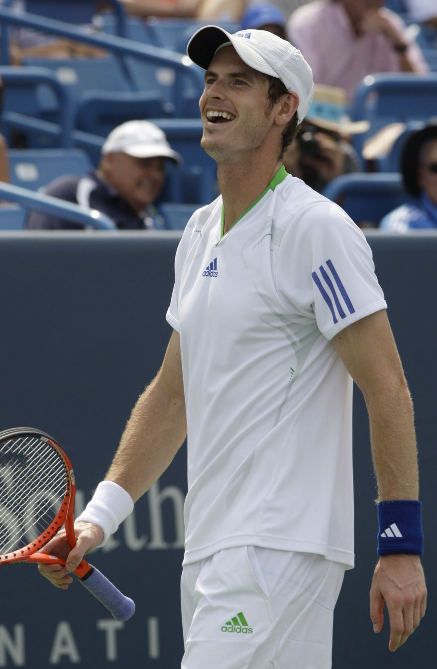 Andy Murray, from Great Britain, smiles after making a shot against Mardy Fish during a semifinal match at the Western & Southern Open tennis tournament, Saturday, Aug. 20, 2011 in Mason, Ohio. Murray won 6-3, 7-6 (8). (AP Photo/Al Behrman)