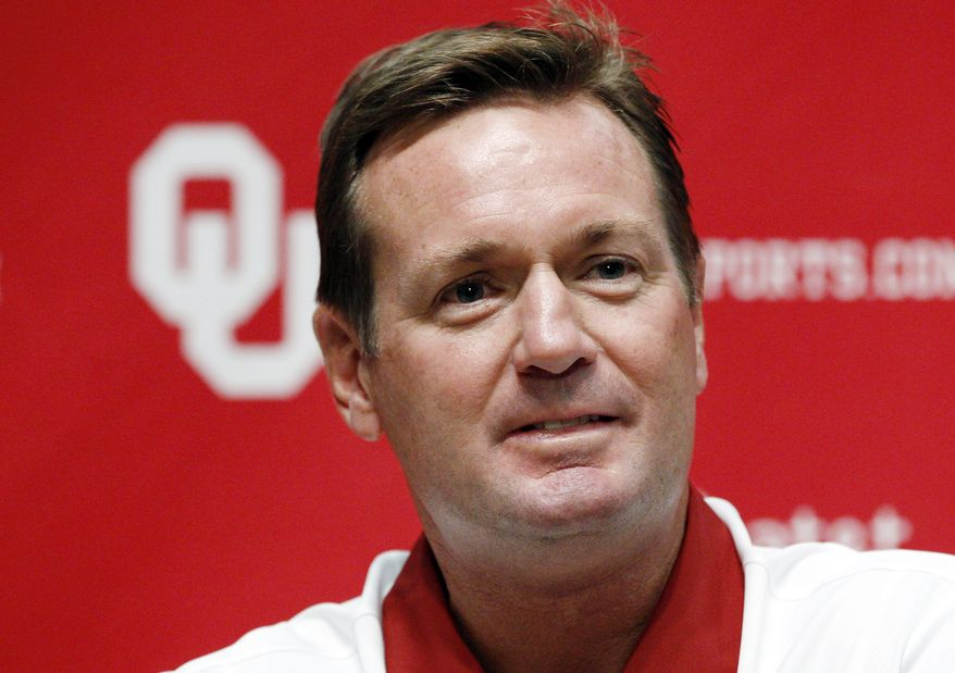 FILE - In this Aug. 6, 2011, file photo, Oklahoma head coach Bob Stoops looks on during Oklahoma football media day in Norman, Okla. The Sooners will start out top-ranked in The Associated Press college football poll for the 10th time, more than any program in the country. (AP Photo/Sue Ogrocki)