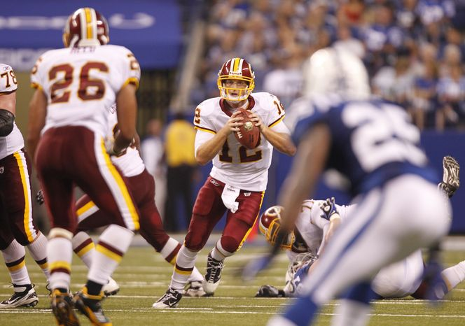 Washington Redskins quarterback John Beck steps up into the pocket during Friday's preseason game against the Indianapolis Colts. In his first start game action since 2007, he completed 14 of 17 passes for 140 yards, no touchdowns and no interceptions in the first half.  (AP Photo/Michael Conroy)