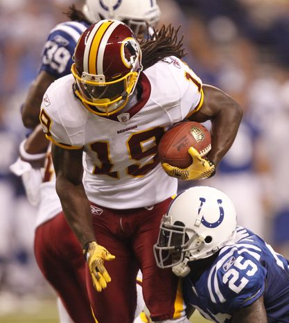 Washington Redskins wide receiver Donte Stallworth gets tackled after hauling in his only catch of the night, a 23-yarder from John Beck. (AP Photo/Michael Conroy)