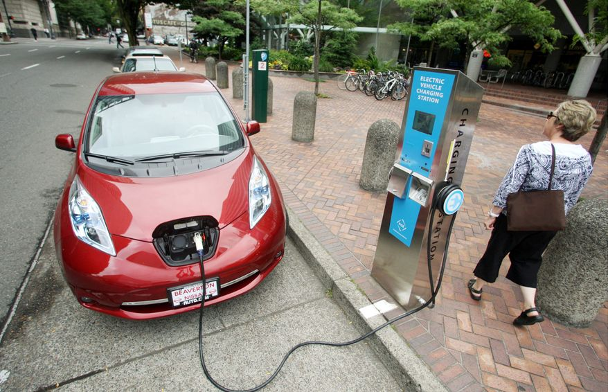 A Nissan Leaf charges at a station in Portland, Ore. (Associated Press)