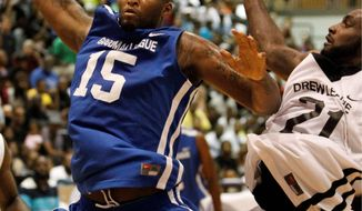 ASSOCIATED PRESS DeMarcus Cousins, playing for Goodman League, snares a rebound next to the Drew League's Doug Thomas.