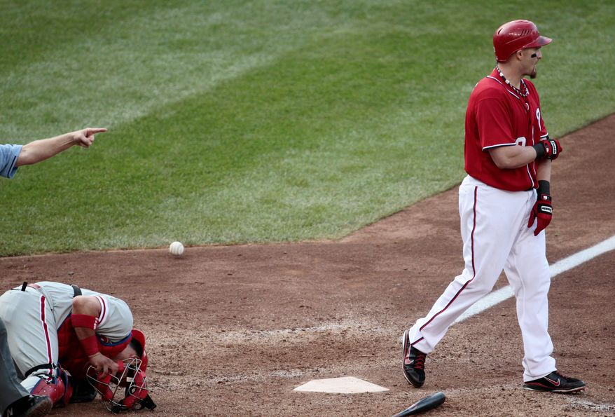 ASSOCIATED PRESS PHOTOGRAPHS  Nationals outfielder Jonny Gomes heads to first after being hit by a pitch to force in the winning run in the 10th inning. Washington took two of three from Philadelphia in the weekend series.