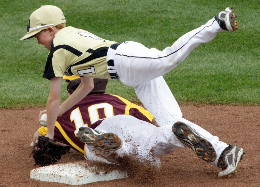 Louisiana's Cain Castille (10) breaks up a double play by taking out Montana second baseman Connor Kieckbusch during the second inning of Montana's 3-1 win in the League World Series. (Associated Press)