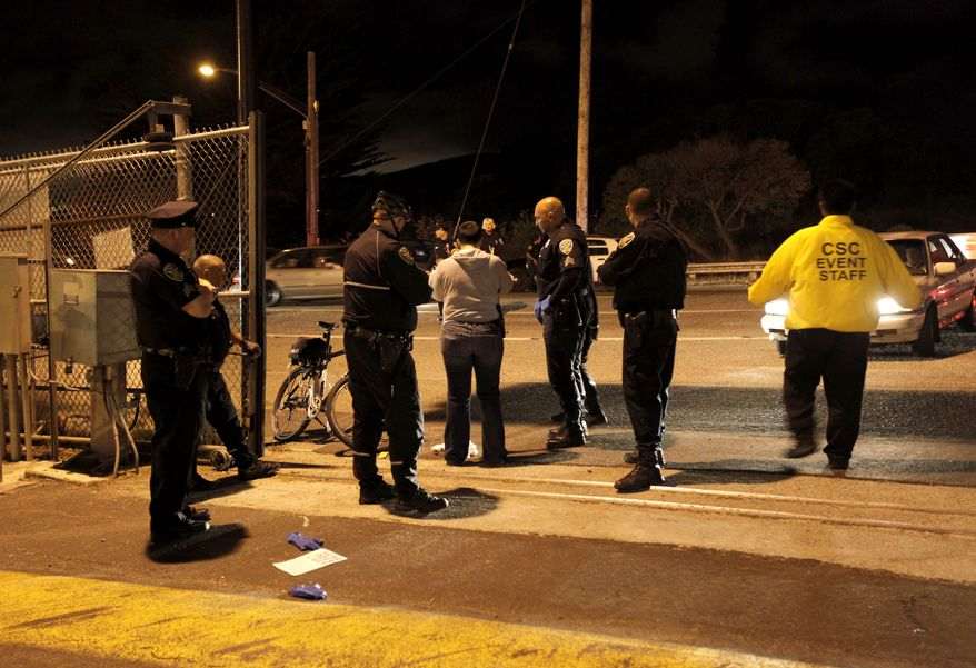 Police investigate the scene of a shooting just outside Candlestick Park in San Francisco, where the San Francisco 49ers had just finished playing the Oakland Raiders on Saturday, Aug. 20, 2011. (AP Photo/Michael Macor, San Francisco Chronicle)
