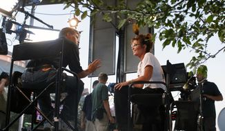 Sean Hannity (left) of Fox News interviews former Alaska Gov. Sarah Palin at the Iowa State Fair in Des Moines, Iowa, on Friday, Aug. 12, 2011. (AP Photo/Charles Dharapak)
