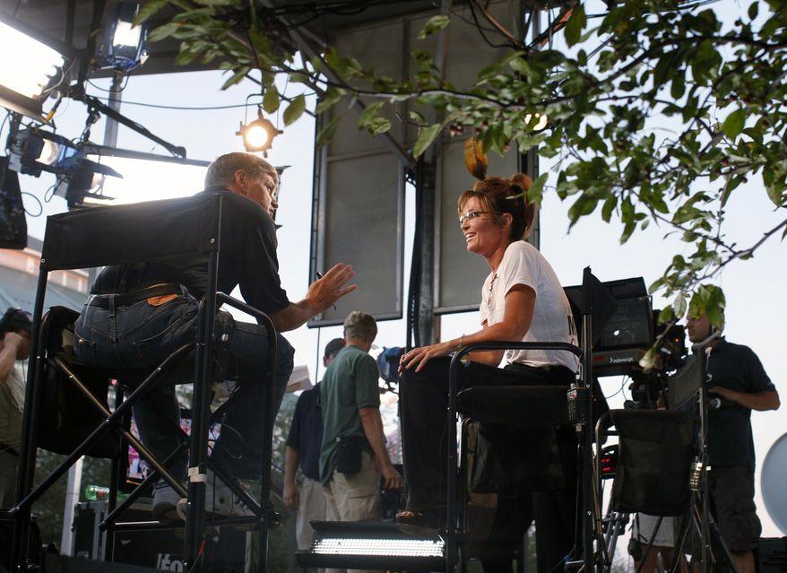 Sean Hannity (left) of Fox News interviews former Alaska Gov. Sarah Palin at the Iowa State Fair in Des Moines, Iowa, on Friday, Aug. 12, 2011. (AP Photo/Charles Dharapak)