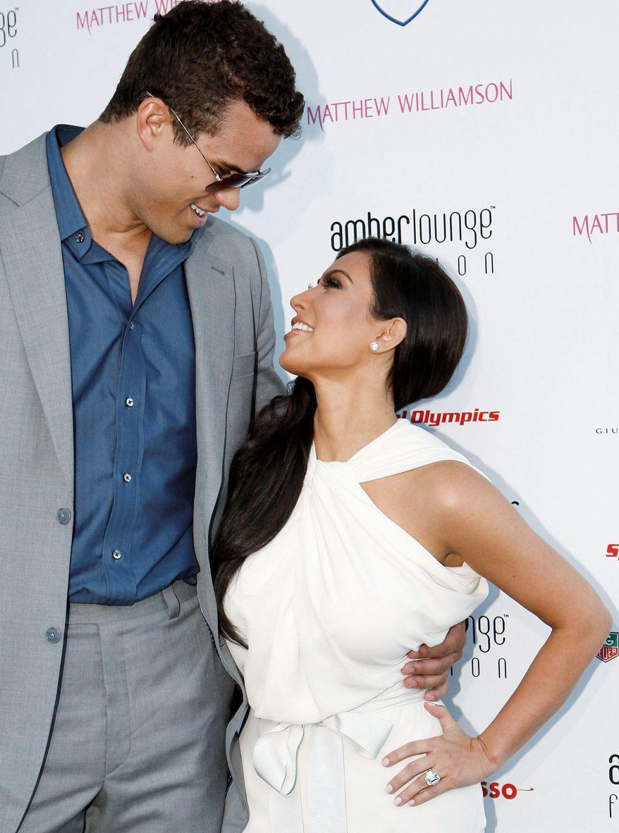 Reality TV star Kim Kardashian and NBA star Kris Humphries turn a multimillion-dollar profit for their high-profile wedding. (Associated Press)
