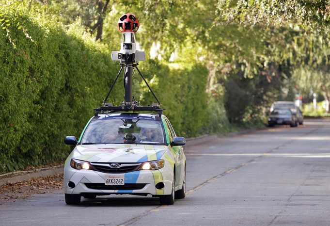 """An employee drives a Google vehicle on Palo Alto, Calif., streets to shoot """"street views"""" in October 2010. Israeli officials announced Sunday they have given Google permission to photograph Israeli streets and cities, with restrictions to ensure that Google's Street View service won't unintentionally aid terrorists in planning attacks on sensitive sites. (Associated Press)"""