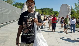 "** FILE ** ""It's a long time coming,"" said Davie Feaster, a Washington, D.C., native, about the new Martin Luther King Jr. Memorial, which opened to the public on Aug. 22, 2011. ""It's breaking down walls,"" he said. Mr. Feaster, who was 3 when the March on Washington took place, says even though he was young, he remembers it. His uncle came down to the Mall and handed out chicken to the masses, so as a tribute, he brought chicken on Monday. (Barbara L. Salisbury/The Washington Times)"