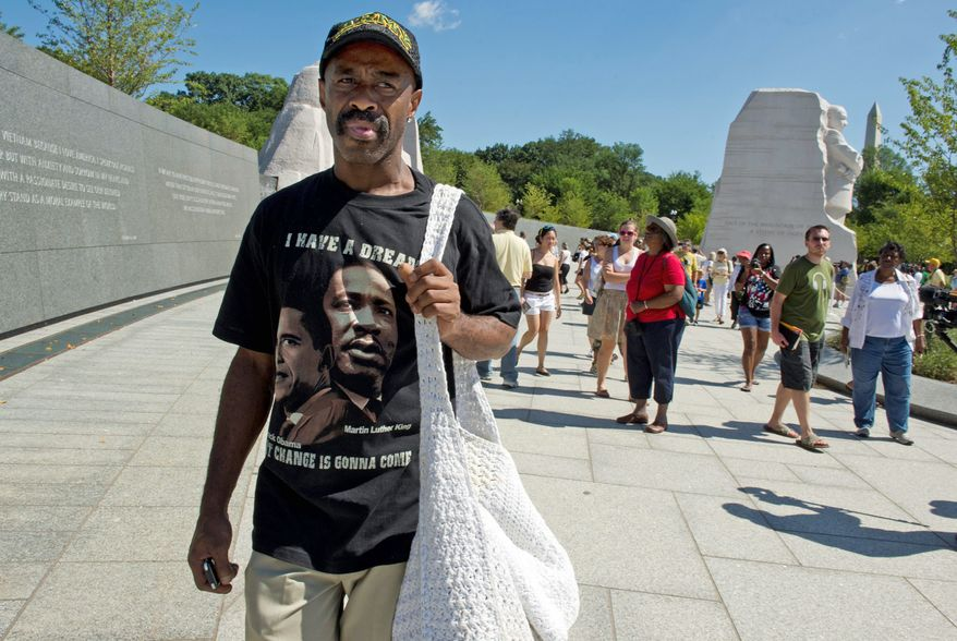 """** FILE ** """"It's a long time coming,"""" said Davie Feaster, a Washington, D.C., native, about the new Martin Luther King Jr. Memorial, which opened to the public on Aug. 22, 2011. """"It's breaking down walls,"""" he said. Mr. Feaster, who was 3 when the March on Washington took place, says even though he was young, he remembers it. His uncle came down to the Mall and handed out chicken to the masses, so as a tribute, he brought chicken on Monday. (Barbara L. Salisbury/The Washington Times)"""