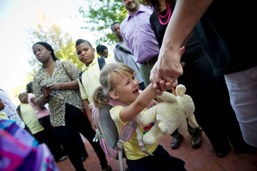 Keith Erickson plays with his five year-old daughter Emily as students arrive for the first day of school at John Tyler Elementary School. (Rod Lamkey Jr./The Washington Times)