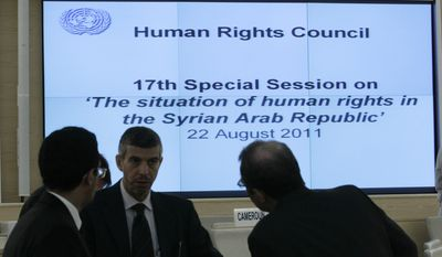 Unidentified delegates speak together before the opening of the U.N. Human Rights Council's special session on Syria taking place at the U.N.'s European headquarters in Geneva on Monday, Aug. 22, 2011. (AP Photo/Keystone/Salvatore Di Nolfi)