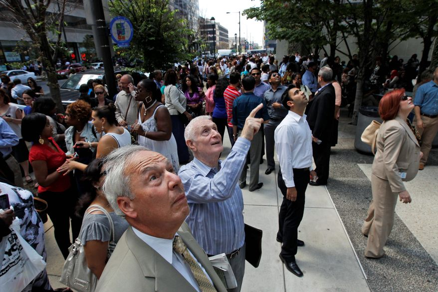 A slew of onlookers stopped and observed a window on Market Street in downtown Philadelphia that was cracked during Tuesday's 5.8-magnitude earthquake that shook the East Coast from Georgia to New England. (Associated Press)