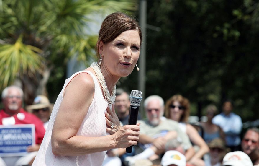 """Republican presidential candidate Michele Bachmann's campaign promise to get gas back down to $2 a gallon if she's elected has created skepticism among energy industry experts. """"Many [politicians] will say or do just about anything to get elected,"""" said Robert Rapier of Consumer Energy Report. (Associated Press)"""