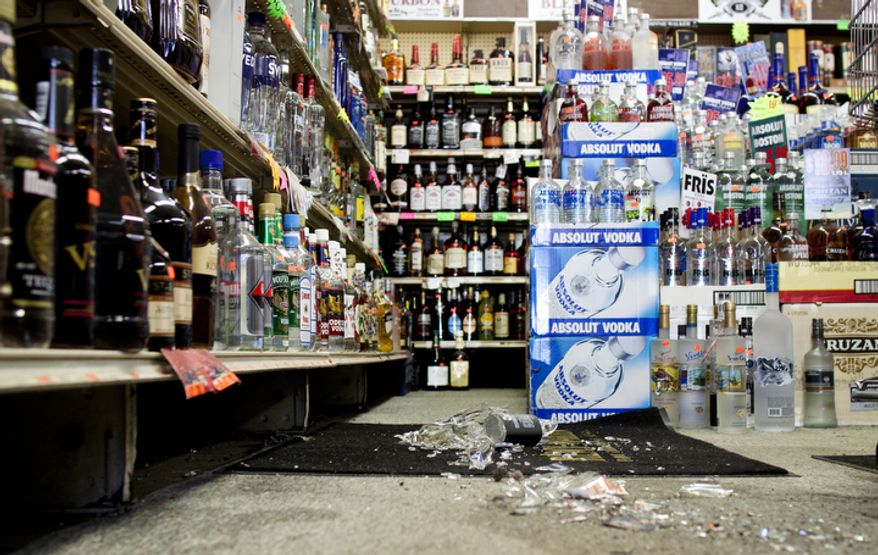 Glass bottles lay shattered on the ground Aug. 23, 2011, at Sammy's Liquor store in northeast Washington, after a 5.8-magnitude earthquake hit much of the East Coast. (Pratik Shah/The Washington Times)