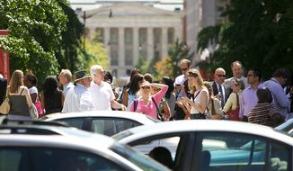 Office workers flood the streets at Mount Vernon Square in Northwest Washington on Tuesday, Aug. 23, 2011, following a 5.8-magnitude earthquake that hit the East Coast of the United States. The quake's epicenter was in Mineral, Va., east of Charlottesville, but the temblor could be felt along much of the Eastern Seaboard. (Andrew Harnik/The Washington Times)
