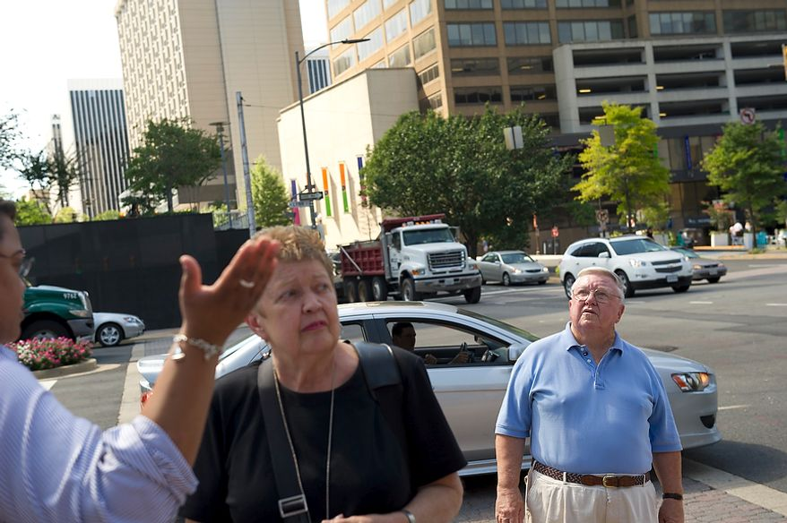 People react to a 5.9 earthquake in Rosslyn, Va, Tuesday, August 23, 2011, which struck at around 2pm EST, with an epicenter outside of Richmond, Va. (Rod Lamkey Jr./The Washington Times)