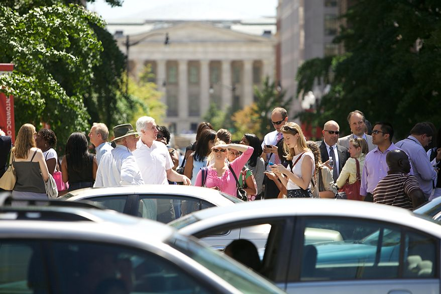 Office workers flood District streets at Mt. Vernon Square in Northwest after a 5.9 earthquake in Virginia is felt in Washington, D.C., Tuesday, August 23, 2011. (Andrew Harnik / The Washington Times)