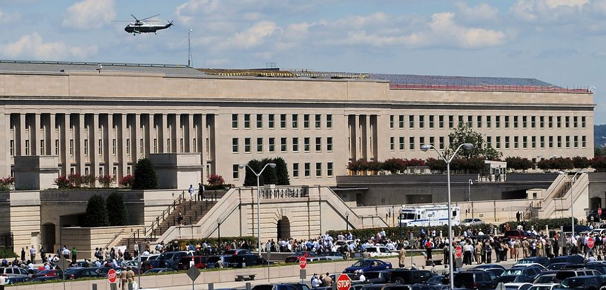 Civilians and military personnel evacuate the Pentagon in Washington after an earthquake was felt on Tuesday, Aug. 23, 2011. (AP Photo/U.S. Navy, Mass Communication Specialist 2nd Class Jason Graham)