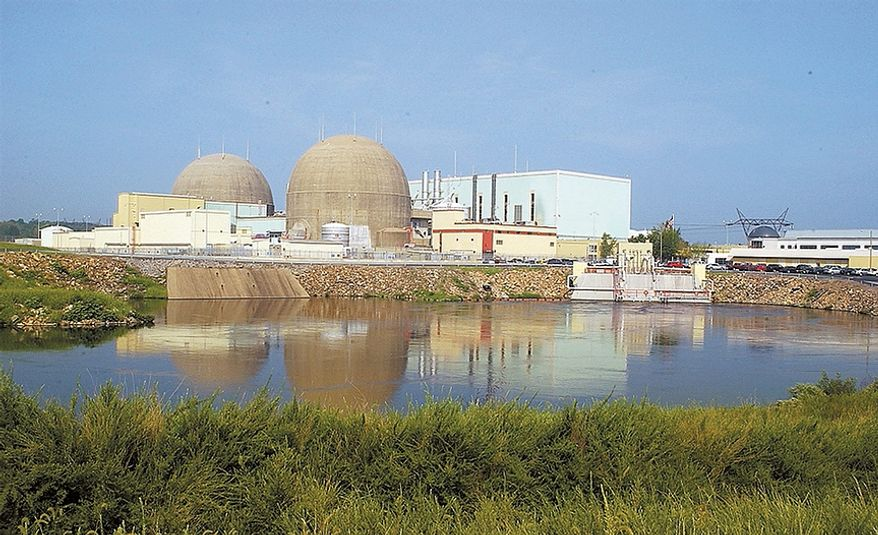 In this Feb. 10, 2005 file photo, The containment domes enclosing the North Anna Power Station's two nuclear reactors rise over a discharge canal at the Louisa  plant in Spotsylvainia county Va. A 5.9 magnitude earthquake centered in Virginia forced evacuations of all the monuments on the National Mall in Washington and rattled nerves from Georgia. Two nuclear reactors at the North Anna Power Station in the same county as the epicenter were automatically taken off line by safety systems around the time of the earthquake, said Roger Hannah, a spokesman for the U.S. Nuclear Regulatory Commission. (AP Photo/the Free Lance-Star, Suzanne Carr-Rossi, File)