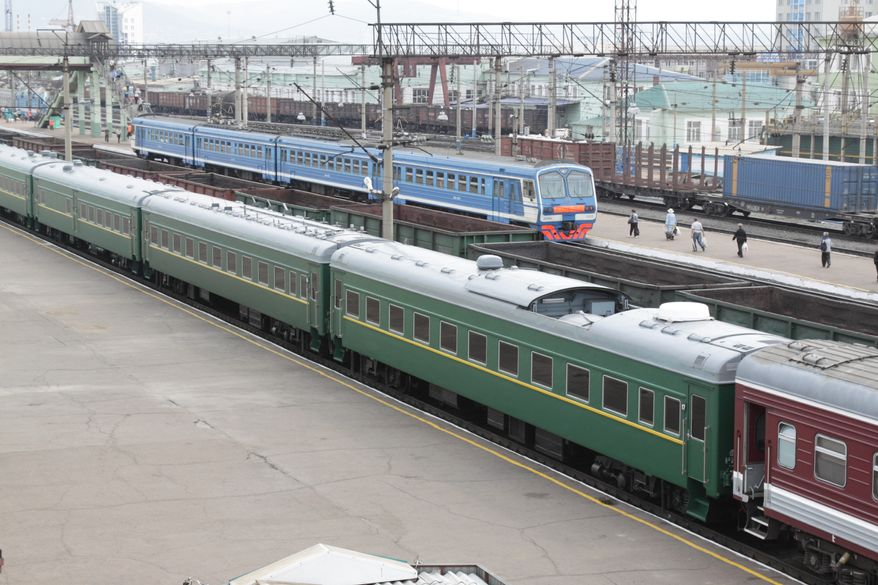 A special armored train (foreground) transporting North Korean leader Kim Jong-il is seen parked at a railway station in Ulan-Ude, Russia, on Tuesday, Aug. 23, 2011. Russian President Dmitry Medvedev is expected to visit the Siberian city Wednesday, apparently to hold summit talks with Mr. Kim, according to a Russian government source. (AP Photo/Anna Ogorodnik)