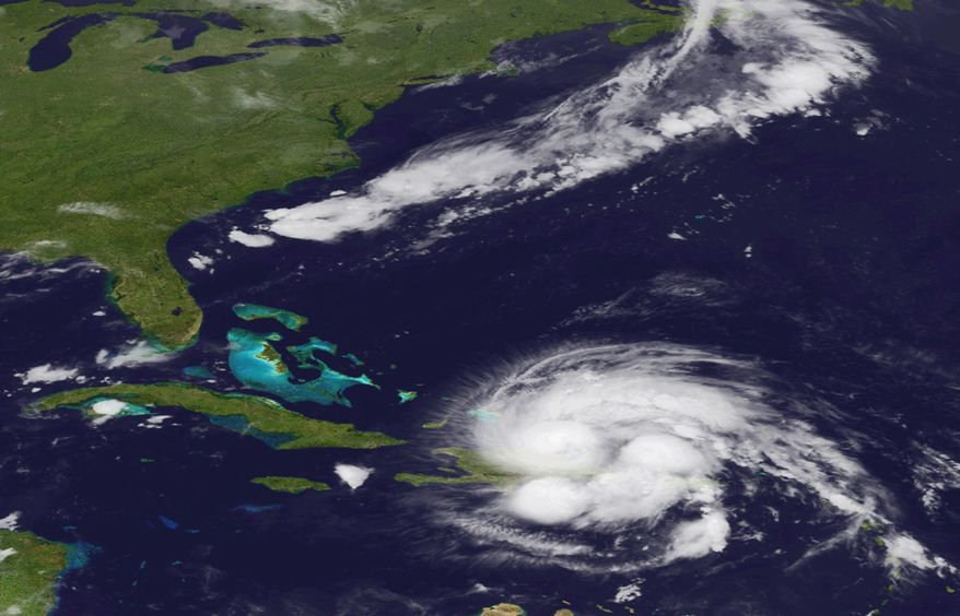 An image released by the National Oceanic and Atmospheric Administration and made from the GEOS East satellite shows Hurricane Irene on Tuesday, Aug. 23, 2011, as it passes over Puerto Rico and the Dominican Republic. The storm is on a track that could see it reach the Southeast coast of the United States as a major storm by the end of the week. (AP Photo/NOAA)