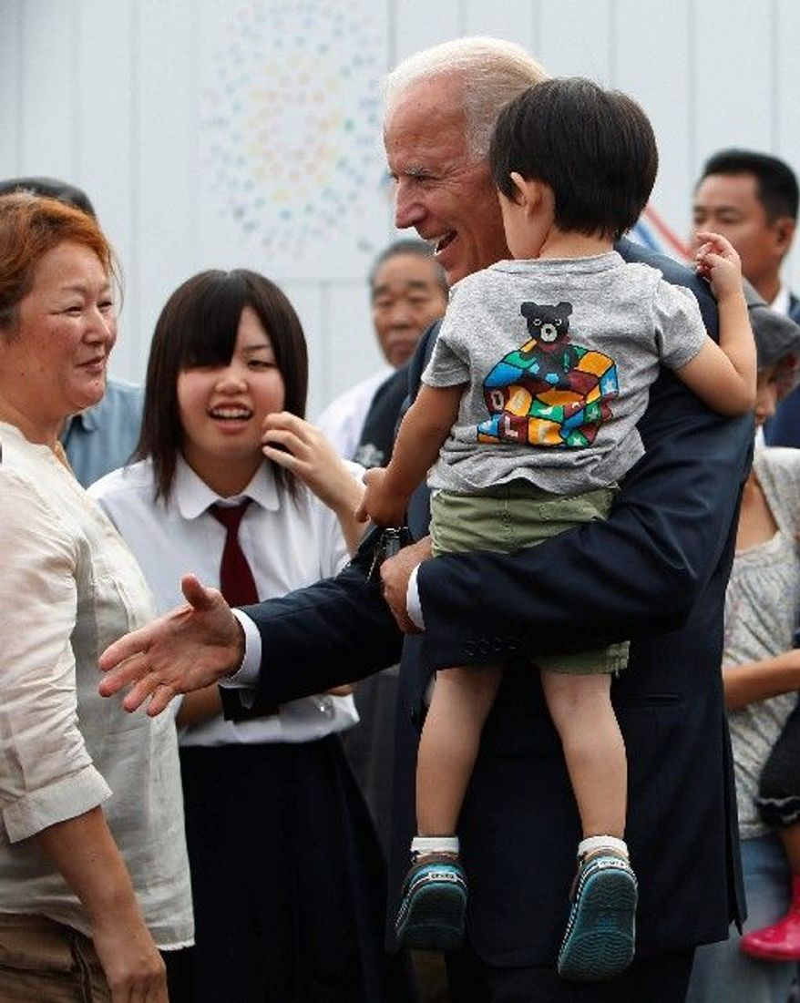 Vice President Joseph R. Biden greets survivors of the Japanese earthquake and tsunami at a temporary-housing complex in Natori, Japan, on Tuesday, two days after making controversial remarks in Chengdu, China. (Associated Press)
